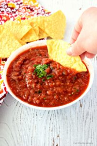 This gluten free and vegan homemade Restaurant Style Salsa is so easy to make and tastes so good! It uses simple ingredients that pack a ton of flavor! #glutenfree #vegan #dairyfree #snacks #easy #salsa