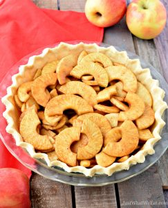 This gluten free, vegan, and refined sugar free Dutch Apple Pie is the perfect Holiday dessert! It has the best flaky pie crust, layers of sweet baked apples, and a sweet and crunchy crumble topping. #glutenfree #dairyfree #vegan #refinedsugarfree #applepie #dessert #pie