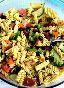 This gluten free and dairy free Pasta Salad tastes SO much like traditional pasta salad and is so easy to make! It's the perfect side dish to bring to your next family gathering! #glutenfree #dairyfree #pasta #sidedish #recipes #easy