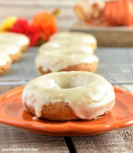 These gluten free, vegan, and refined sugar free pumpkin donuts are SO GOOD! They have the most wonderful pumpkin and warm spice flavor! They are the perfect Fall breakfast treat! #glutenfree #dairyfree #vegan #fall #dessert #breakfast