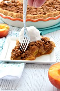 Peach Pie - This Peach Pie is filled with fresh peaches and topped with the most delicious crumble topping. It's gluten free, vegan, refined sugar free, and tastes amazing! #glutenfree #dairyfree #recipes #pie #dessert #vegan #peach
