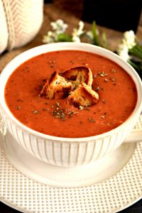 Creamy Roasted Tomato Soup ~ This gluten free and vegan Creamy Roasted Tomato Soup is WONDERFUL! There is so much flavor packed in each bowl. It's creamy, warm, and delicious!