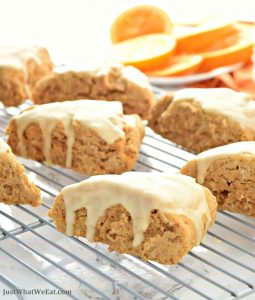 These gluten free, vegan, and refined sugar free orange scones are the perfect breakfast treat! The orange zest and fresh squeezed orange juice give these scones the most delicious flavor!