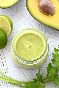 This Avocado Cilantro Lime Dressing is so easy to make and packed with flavor! It's gluten free, vegan, and goes perfectly on salads, tacos, and so much more! #glutenfree #dairyfree #vegan #eggfree #dressing #salad #tacos